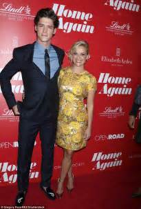 Reese Witherspoon dons yellow for a Home Again screening