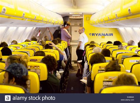 Passengers in a queue for the toilet during a flight